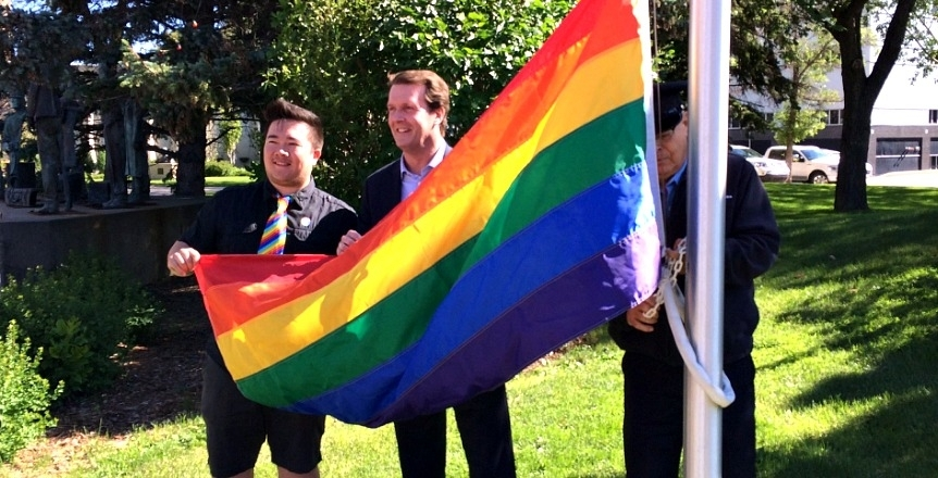 Regina Mayor Michael Fougere, Dan Shier, co-chair of QC PRIDE raise the Pride Flag at Regina City Hall (Photo: Meaghan Willis)